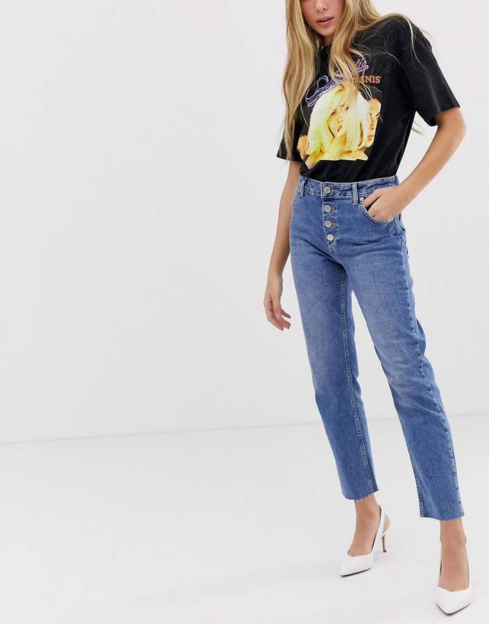straight leg jeans with button front in mid wash