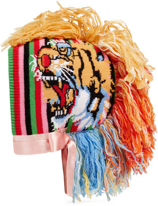 Knitted rainbow hat with tassel Mohawk $1,440 thestylecure.com