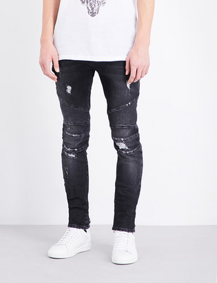 Balmain Biker distressed slim-fit skinny jeans $700 thestylecure.com