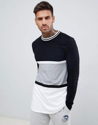 Asos DESIGN muscle fit longline long sleeve t-shirt with curved hem in monochrome color block