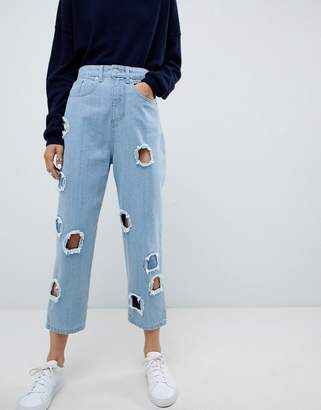 Asos Ovoid Circle Cut Out Jean In Midwash Blue