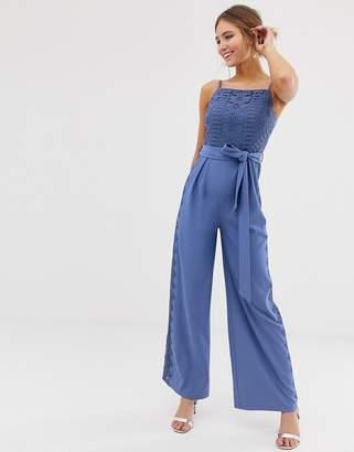 68defabb7c7 Little Mistress square neck jumpsuit with lace leg inserts in blue