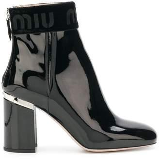 Miu Miu varnished logo boots