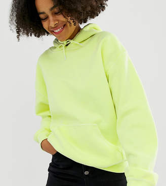 740044c64d4 Reclaimed Vintage inspired overdye hoodie in bright yellow