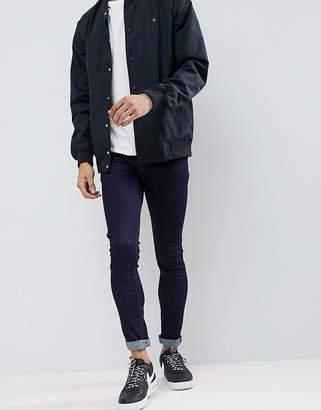 Asos DESIGN Super Skinny Jeans In Indigo