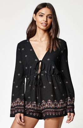 Kendall & Kylie Tie Front Long Sleeve Romper $49.95 thestylecure.com
