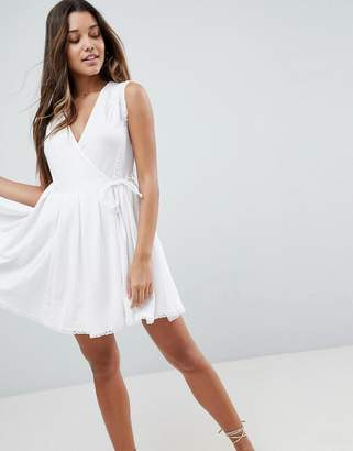 Asos DESIGN Mini Wrap Sundress with Embroidered Trims