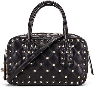 Valentino Rockstud Spike Small Duffle Bag in Nero | FWRD
