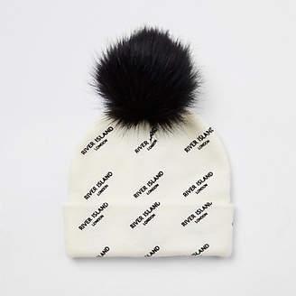 River Island Girls cream faux fur bobble RI beanie hat