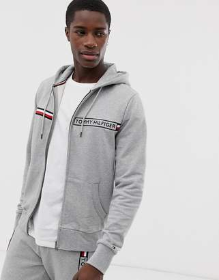 c72bc5d6b Tommy Hilfiger zip through hoodie with logo chest stripe in grey