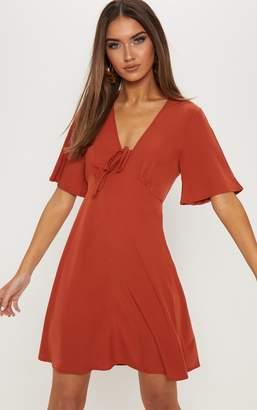 PrettyLittleThing Rust Tie Detail Swing Dress