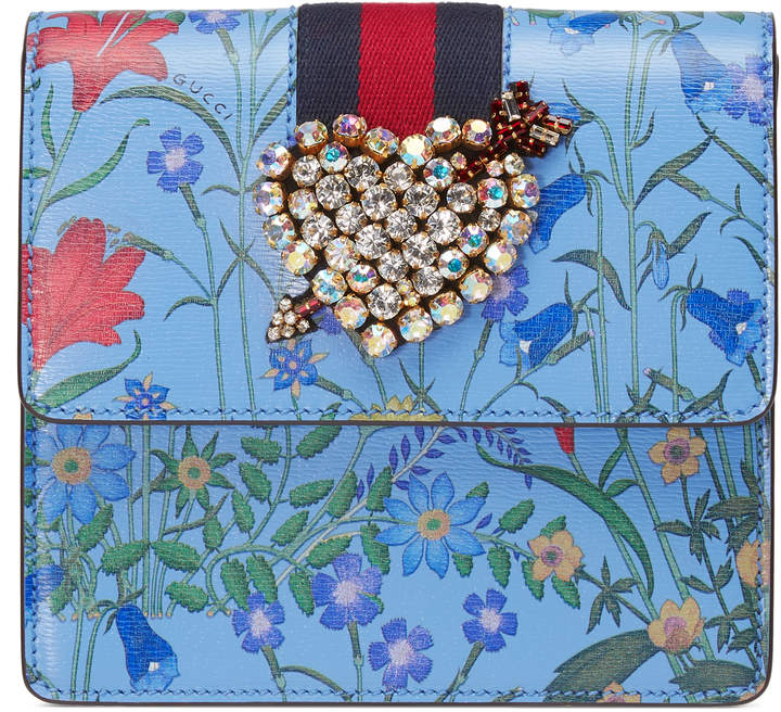 GucciTotem New Flora print leather clutch