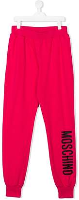 Moschino Kids logo track pants