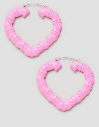 Asos DESIGN hoop earrings with vintage style bamboo design in pink