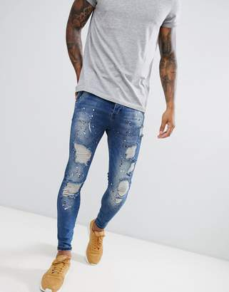 SikSilk skinny fit low rise jeans with paint splat in dark blue