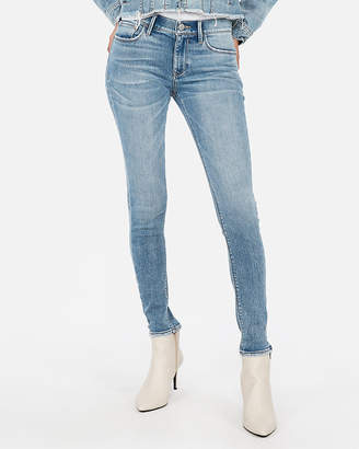 Express Petite Mid Rise Light Wash Fleece Stretch Jean Leggings