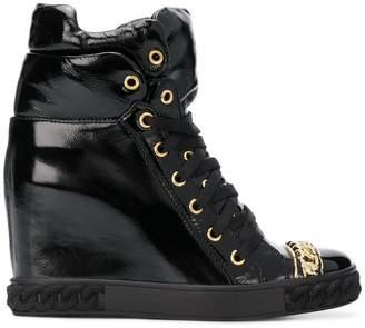 Casadei chain trim patent boots