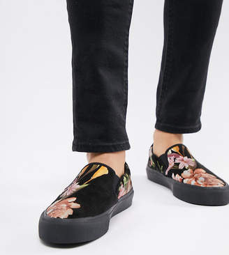 Asos DESIGN Wide Fit slip on plimsolls in black with floral print