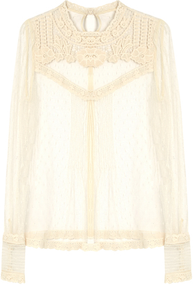 REDVALENTINO Long-sleeved lace top $650 thestylecure.com