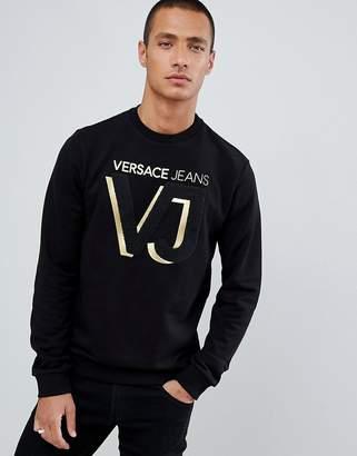 Versace sweatshirt in black with gold chest logo