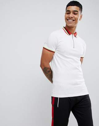 Asos DESIGN muscle fit polo shirt with ring neck pull and contrast collar and cuff tipping