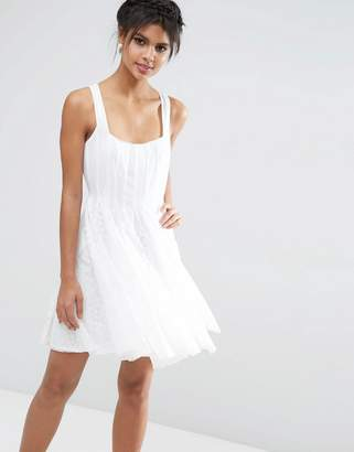ASOS Mesh Fit And Flare Mini Skater With Lace Inserts $89 thestylecure.com