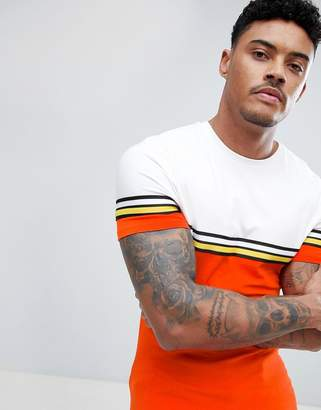 Asos DESIGN muscle longline t-shirt with bright color block and taping in orange