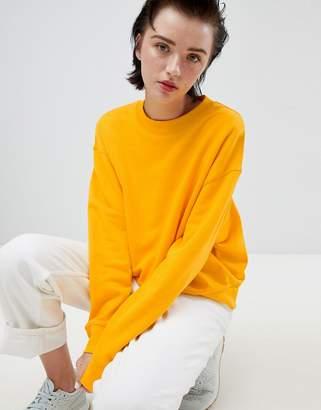 Weekday cropped sweatshirt in warm yellow
