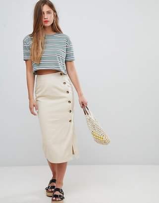 Asos DESIGN denim wrap midi skirt with tortoiseshell buttons