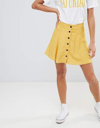 Bershka spot detail button front mini skirt in yellow