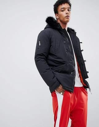 Criminal Damage parka jacket in black with faux fur hood