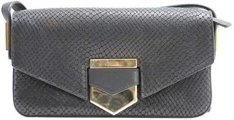 Times Arrow Black Leather Clutch Bag