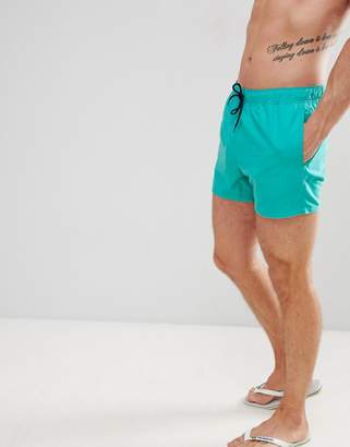 Asos DESIGN swim shorts in turquoise with navy drawcords short length