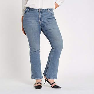 River Island Plus blue wash high rise flared jeans