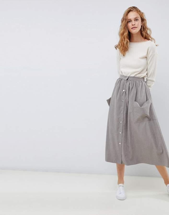 ASOS DESIGN popper front midi skirt with pockets