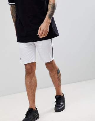 Asos DESIGN slim shorts in white with black piping