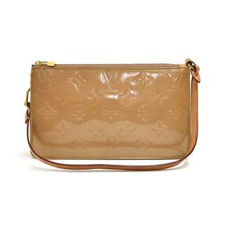 Louis Vuitton Lexington Beige Patent leather Clutch bags