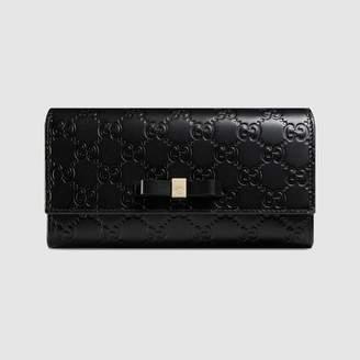 Gucci Bow Signature continental wallet