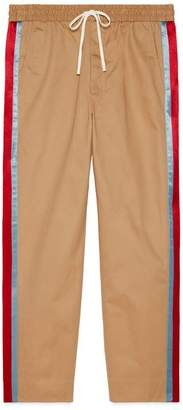Gucci Cotton drill trousers with acetate stripe