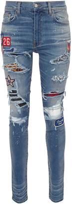 Amiri Mix appliqué paint splatter ripped skinny jeans