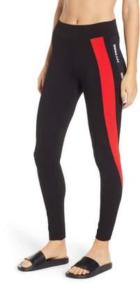 Ivy Park R) Asymmetrical Logo Stripe Leggings