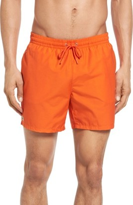 Men's Lacoste Solid Swim Trunks $75 thestylecure.com