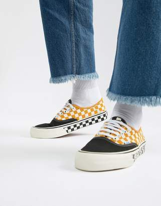 Vans Authentic checkerboard plimsolls in yellow VN0A3MU6U6T1