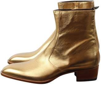 Saint Laurent Gold Leather Boots