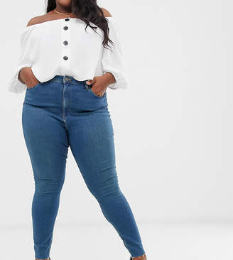 Asos DESIGN Curve Ridley high waisted skinny jeans in aged wash blue with raw hem detail