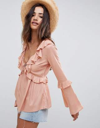Asos DESIGN top with deep v neck and lace up detail