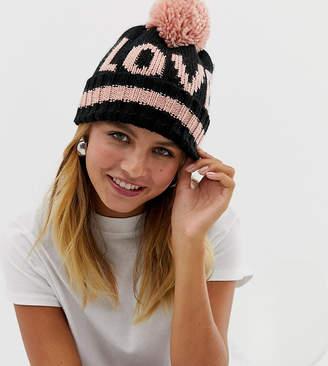 6017b139529 New Look love slogan bobble hat in black pattern
