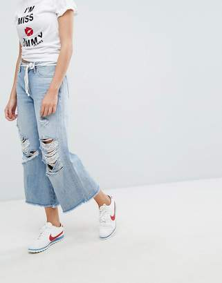 Tommy Jeans Annie Mid Rise Culotte with Raw Hem and Ripped Knee