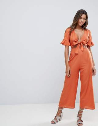 Asos Design DESIGN tea jumpsuit with cut out and tie detail in linen
