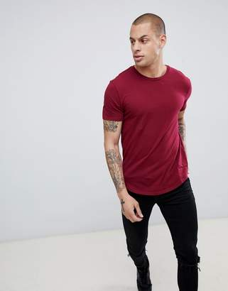 Religion muscle fit t-shirt with dropped hem in red
